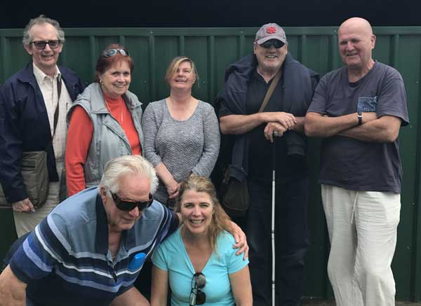 Group of seven vision impaired people